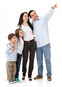 Family pointing somewhere - isolated over a white background