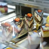 picture of bakeshop  - Cake and pastry in window display canteen food dessert tasty - JPG