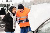 Woman answering inquiry broken car snow mechanic assistance road winter
