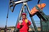 Happy Oil Worker With Money And Pump Jack