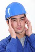 Builder suffering from headache