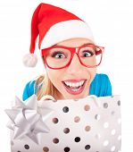 Funny santa girl giving a present
