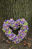 picture of sympathy  - Heart shaped sympathy flowers in different shades of purple - JPG
