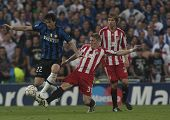MADRID, SPAIN. 22/05/2010. Milan's forward Diego Milito is fouled by Munich's midfielder Bastian Sch