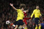 LONDON, ENGLAND. 31/03/2010. Barcelona player Carles Puyol fouls Arsenal player Cesc Fa?bregas (capt