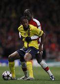 LONDON, ENGLAND. 31/03/2010. Barcelona's Seydou Keita and Arsenal player Bacary Sagna in action duri