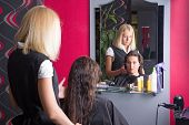 Beautiful Hairdresser And Customer In Beauty Salon