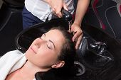 Beautiful Woman Getting A Hair Wash In Beauty Salon