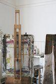 Still life of paint splattered easels in art studio