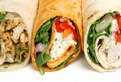 Wrap sandwiches containing chicken and cheese.