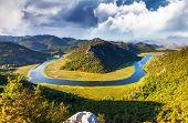 Sinuous river flowing through mountains. Rijeka Crnojevica. Located near Skadar Lake, Montenegro, Europe. Beauty world.