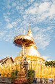 Phra That Hari Phunchai Golden Pagoda In Thai Temple At Lamphun Province, Northern Thailand.