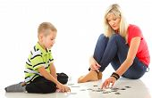 Mother Playing Puzzle Together With Her Son