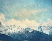 Painting with a snow high mountains landscape