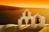stock photo of greek-island  - Beautiful sunset in Oia village in Santorini island - JPG