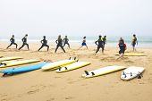 VALE FIGUEIRAS - JULY 10:  Surfers doing exercises before surfing on the the famous surfers beach Va