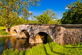 stock photo of battlefield  - Burnside Bridge along Antietam Creek in Antietam National Battlefield Maryland - JPG