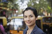 Closeup portrait of beautiful young businesswoman on city street