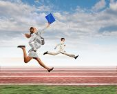 Image of business people running on tracks. Competition concept
