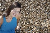 picture of herne bay beach  - Portrait of beautiful young woman smiling while sitting at beach - JPG