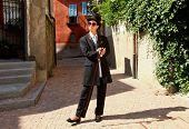 Woman in exterior, protrait, black dress