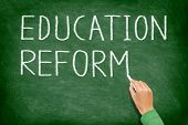 Education reform - school reform concept blackboard. Teacher or student writing EDUCATION REFORM on green chalkboard. Primary school, secondary school, high school or college university.