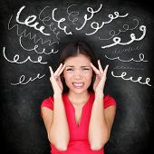 Stress - woman stressed with headache. Female stressed and worried with migraine headache pain. Blac