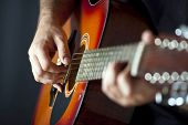 stock photo of guitarists  - Man playing guitar - JPG