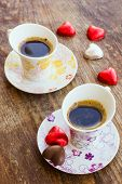 Two Cups Of Coffee With Heart Shaped Candy
