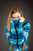 teen girl posing in sweater