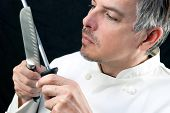 Chef Sharpens Knife