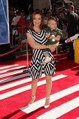Alyssa Milano with her child at the World Premiere Of Disney's Planes, El Capitan, Hollywood, CA 08-05-13