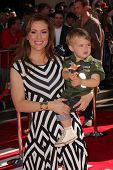 Alyssa Milano with child at the World Premiere Of Disney's Planes, El Capitan, Hollywood, CA 08-05-13