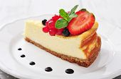 pic of cheesecake  - Cheesecake with fresh berries and mint on plate closeup - JPG