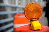 stock photo of barricade  - A Caution flashing lamp at hazard zone NYC - JPG
