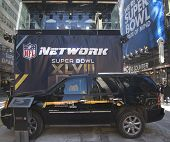 GMC SUV in the front of NFL Network broadcast set on Broadway during Super Bowl XLVIII week