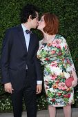 Geoffrey Arend and Christina Hendricks kissing at The Rape Foundation's Annual Brunch, Private Locat