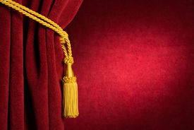 stock photo of tassels  - Red theatre curtain and yellow tassels - JPG