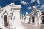 Row Of White Pagodas In Maha Lokamarazein Kuthodaw Pagoda In  Myanmar.