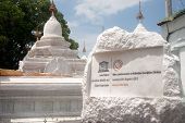 The Label Of White Pagodas In Maha Lokamarazein Kuthodaw Pagoda In  Myanmar.