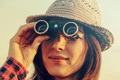 Woman Looks Through Binoculars