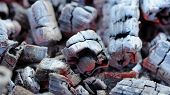 image of ember  - A close-up of glowing wood embers for barbeque