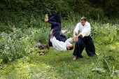 image of aikido  - Training martial art Aikido. On nature. outdoors.