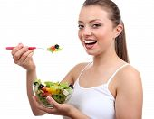 Beautiful girl with fresh salad, isolated on white