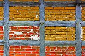 Old Adobe And Brick Wall Of Half Timbered House