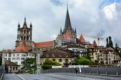 LAUSANNE, SWITZERLAND - JULY 7, 2014: The Cathedral of Notre Dame of Lausanne rises above the city.