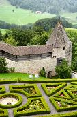 GRUYERES, SWITZERLAND - JULY 8, 2014: Garden and ramparts at Gruyeres Castle. Located in the medieva