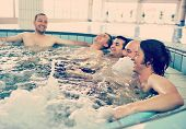 Group of young peoples enjoying on pool and jacuzzi