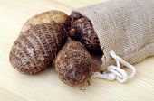 foto of taro corms  - some taro root display on market place - JPG
