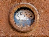 Old Meter On Rusty Iron Surface